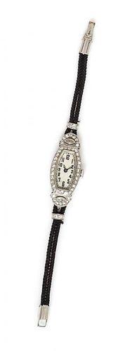 An Art Deco Platinum and Diamond Wristwatch, J.E. Caldwell,