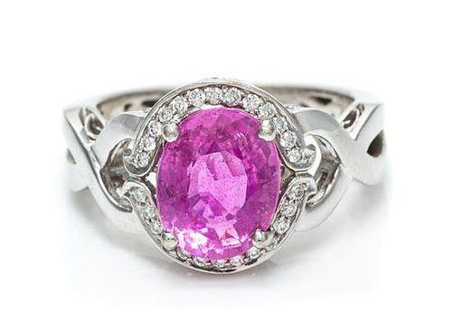 A 14 Karat White Gold, Pink Sapphire, and Diamond Ring, 4.60 dwts.