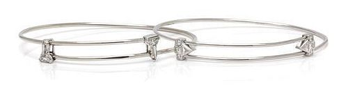 A Collection of White Gold, Platinum and Diamond Bangle Bracelets, 8.90 dwts.