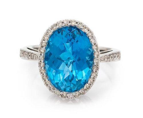A 14 Karat White Gold, Blue Topaz and Diamond Ring, 3.90 dwts.