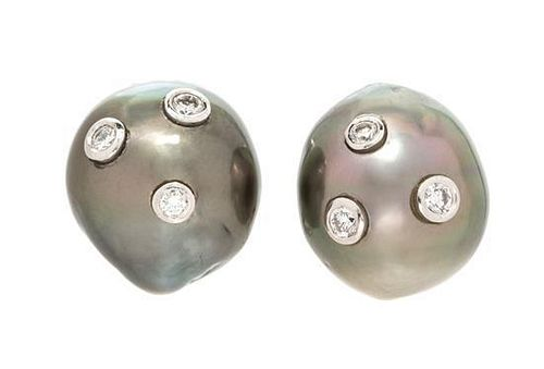 A Pair of White Gold, Cultured Tahitian Pearl and Diamond Earclips, 7.00 dwts.