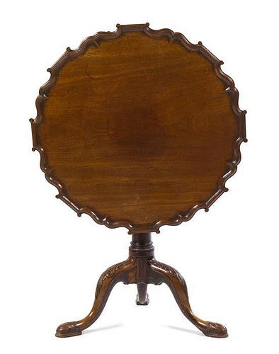 A George III Mahogany Piecrust Tilt-Top Tea Table Height 27 x diameter of top 29 inches.