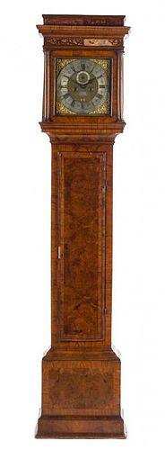 * A George II Walnut Tall Case Clock Height 88 5/8 inches.