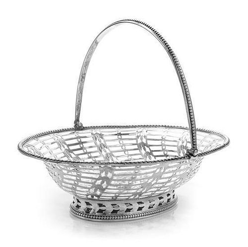 A George III Silver Reticulated Sweetmeat Basket, Hester Bateman, London, 1780, of oval form with a beaded edge and a swing hand