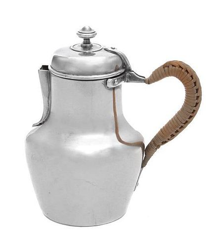 A French Silver Creamer, Maker's Mark Obscured, having a woven wicker handle, the body with engraved monogram GM.