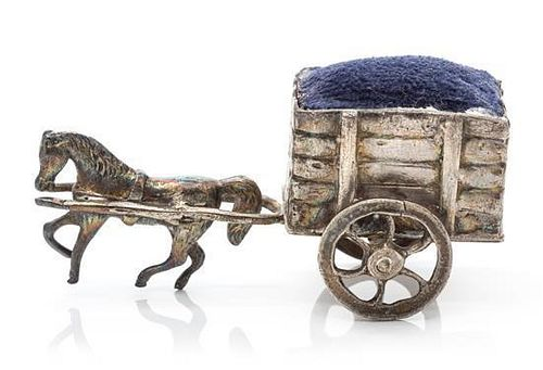 A German Silver Pin-Cushion, Hanau Marks, 19th Century, in the form of a horse pulling a cart.