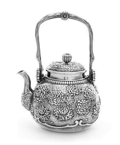 A Chinese Export Silver Teapot, , the body of globular form, finely chased with blooming chrysanthemums, having a curved side sp