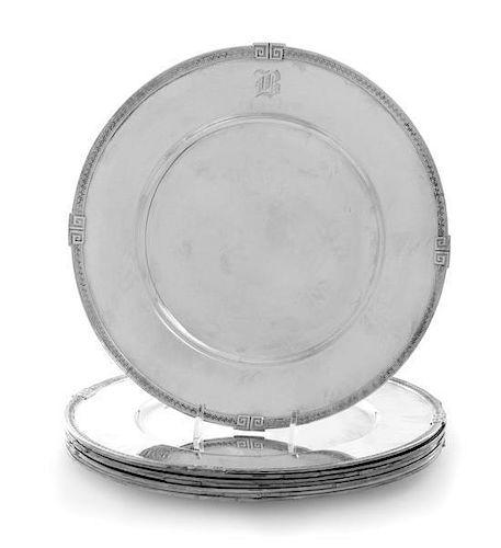 A Set of Seven American Silver Dinner Plates, Gorham Mfg. Co., Providence, RI, each having a Greek key decorated border.
