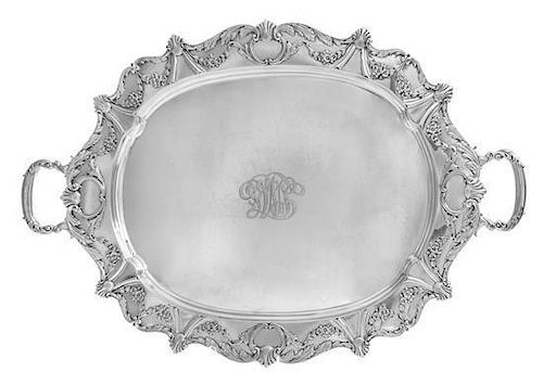 An American Silver Two-Handled Serving Tray, Jennings Silver Co., Irvington, NJ, the rim decorated with rocaille, floral swag an