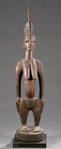 Yoruba standing female shrine figure, early 20th c