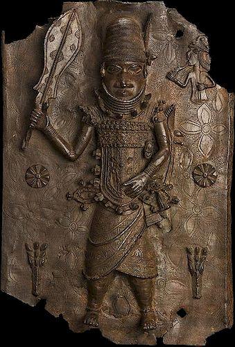 Benin brass plaque with single figure.