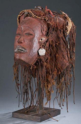 Female Pwo mask with elaborate fiber coiffure