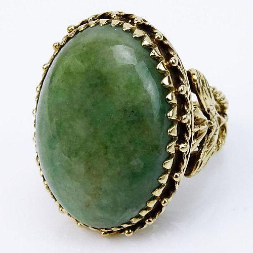 Vintage Cabochon Green Jade and Filigree 14 Karat Yellow Gold Ring.
