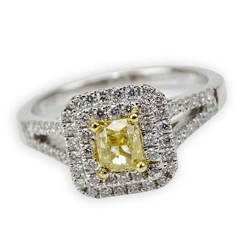 .50 Carat Cushion Cut Natural Fancy Yellow Diamond, .41 Carat Round Cut Diamond and 18 Karat White Gold Ring