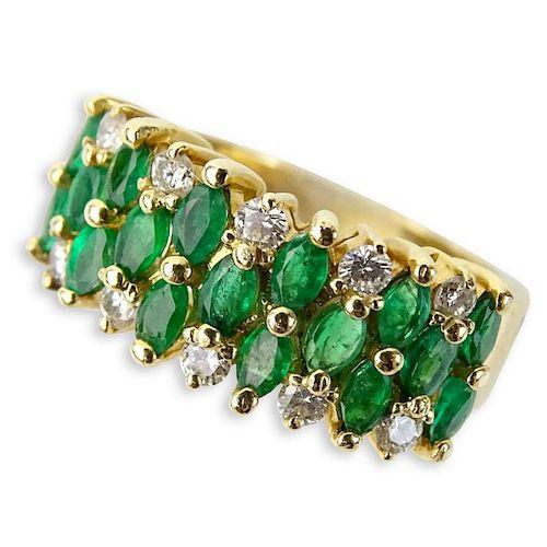 Vintage Oval Cut Emerald, Round Brilliant Cut Diamond and 14 Karat Yellow Gold Ring