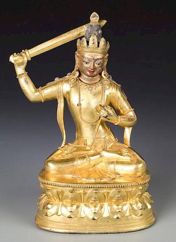 Antique Sino-Tibetan Gilt Bronze Buddha with Sword