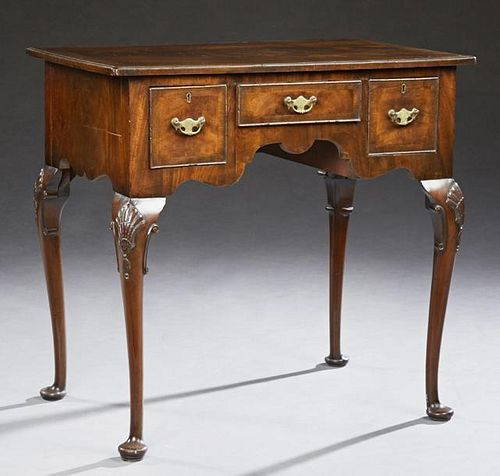 English Carved Banded Mahogany Queen Anne Lowboy,