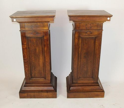 Pair of American oak exhibition pedestals