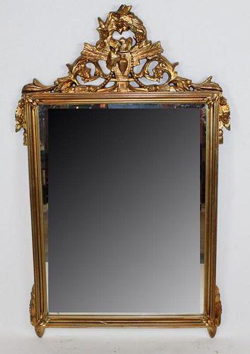 Gilt Louis XVI style mirror