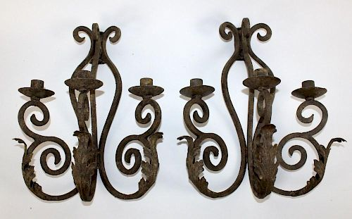 Pair of scrolled iron candle sconces