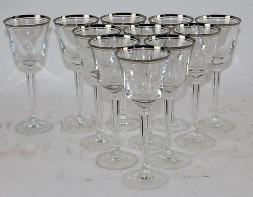 Set of 11 crystal wine glasses with silver rim