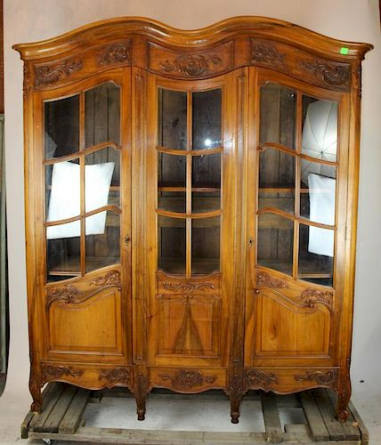French Louis XV 3 door bookcase with paned glass.