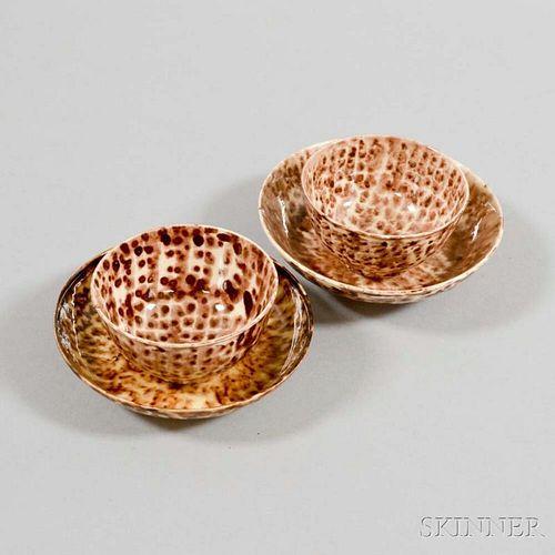 Two Tortoiseshell-glazed Earthenware Teacups and Saucers