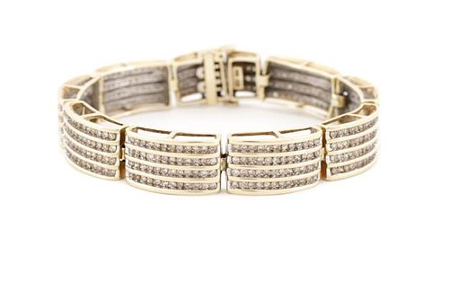 Ladies 10K Gold & Channel Set Diamond Bracelet