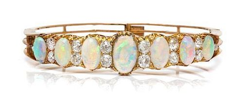 A Victorian Yellow Gold, Opal and Diamond Bangle Bracelet, 13.90 dwts.