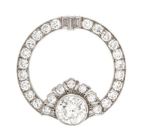 A Platinum and Diamond Circular Brooch, 3.70 dwts.