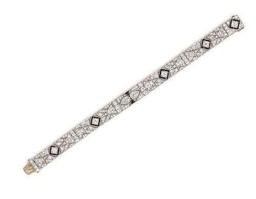 An Art Deco Platinum, Onyx and Diamond Bracelet, 23.35 dwts.