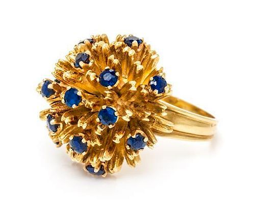 An 18 Karat Yellow Gold and Sapphire Ring, 10.90 dwts.