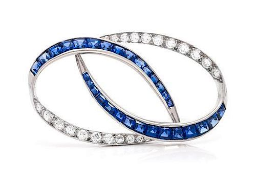 A Platinum, Diamond and Sapphire Brooch, Oscar Heyman Brothers, 6.00 dwts.