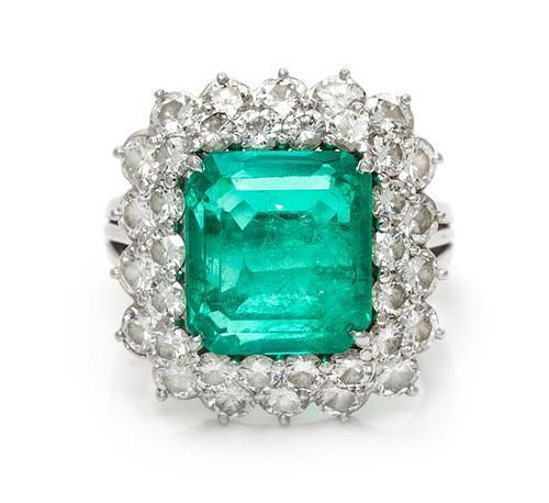 * A Platinum, Emerald and Diamond Ring, 7.90 dwts.
