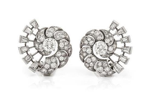 A Pair of Platinum and Diamond Earclips, 9.90 dwts.