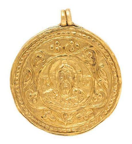 * A High Karat Yellow Gold Byzantine Era Medallion/Pendant, 17.41 dwts.