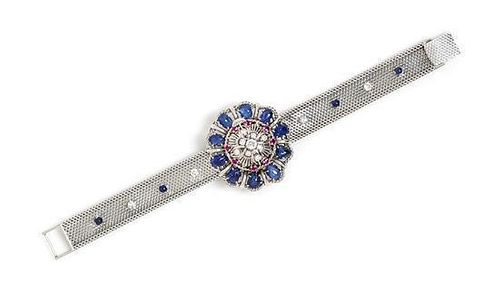 An 18 Karat White Gold, Sapphire, Ruby and Diamond Surprise Wristwatch, 39.10 dwts.