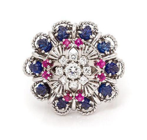 An 18 Karat White Gold, Sapphire, Ruby and Diamond Ring, 10.90 dwts.