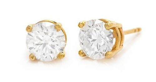 A Pair of Yellow Gold and Diamond Stud Earrings, Hearts on Fire, 2.70 dwts.