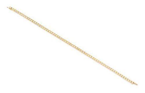 """An 18 Karat Yellow Gold and Diamond """"Laniere"""" Line Bracelet, Cartier, 10.50 dwts."""