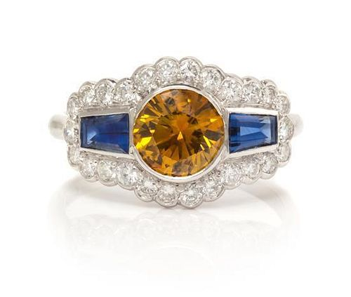 An 18 Karat White Gold, Colored Diamond, Sapphire and Diamond Ring, 2.70 dwts.