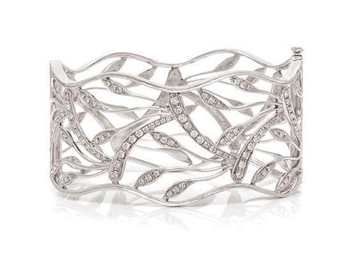 * A White Gold and Diamond Openwork Bangle Bracelet, 25.80 dwts.