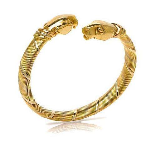 An 18 Karat Tri Color Gold Panthere Bypass Bracelet, Cartier, 31.40 dwts.