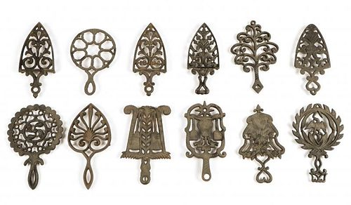 12 Antique Cast Iron Trivets
