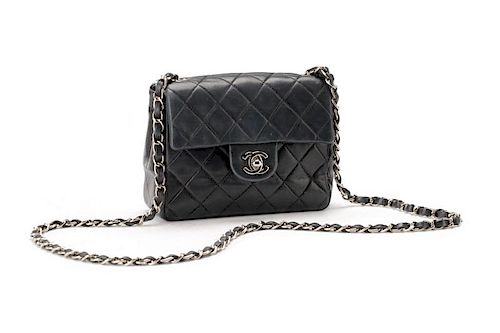 Chanel Navy Quilted Lambskin Mini Classic Flap Bag. Lot 1044. Prev Lot ·  Next Lot · item Image 6bf4da1bae1e1