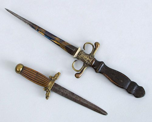 TWO DECORATIVE BRASS-MOUNTED WOOD AND METAL DAGGERS