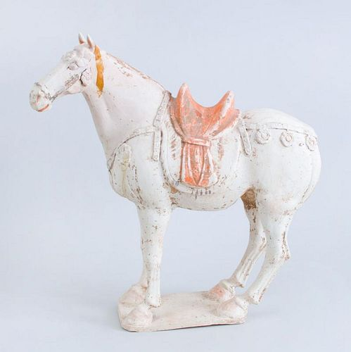 TANG UNGLAZED PAINTED POTTERY FIGURE OF A SADDLED HORSE