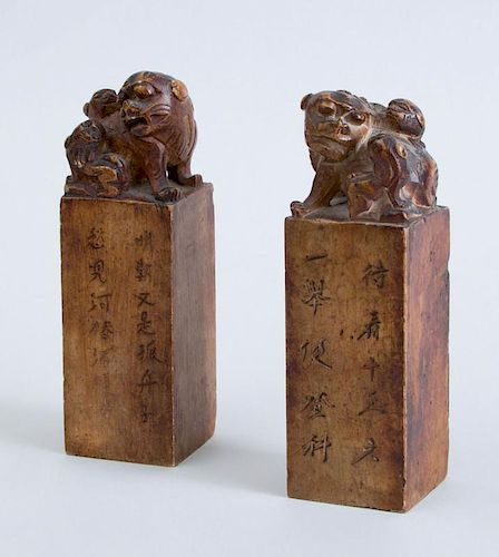 PAIR OF CHINESE CARVED SOFTSTONE CHOPS WITH FU DOGS AND PUPS