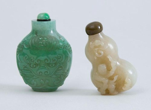 TWO CHINESE CARVED JADE SNUFF BOTTLES AND STOPPERS