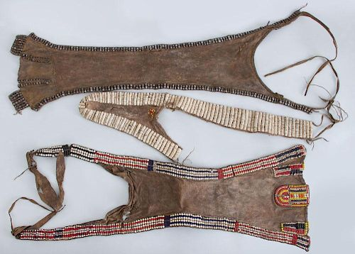 THREE AFRICAN BEADED HYDE APRONS, CACHE SEXE